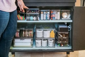 cabinet-with-clear-containers-of-craft-supplies