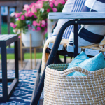 basket-and-bench-swing-on-blue-rug-on-deck