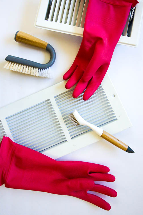 flatlay-with-pink-rubber-gloves-and-white-air-vents