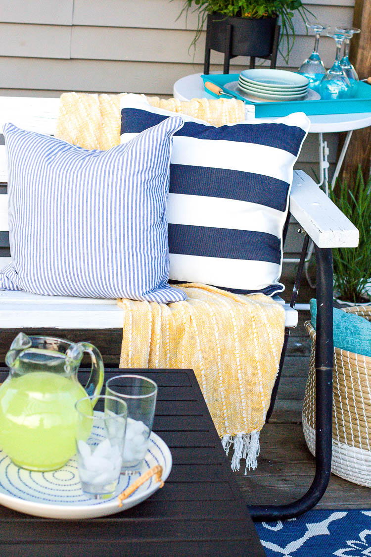 bench-swing-with-blue-and-white-striped-pillows