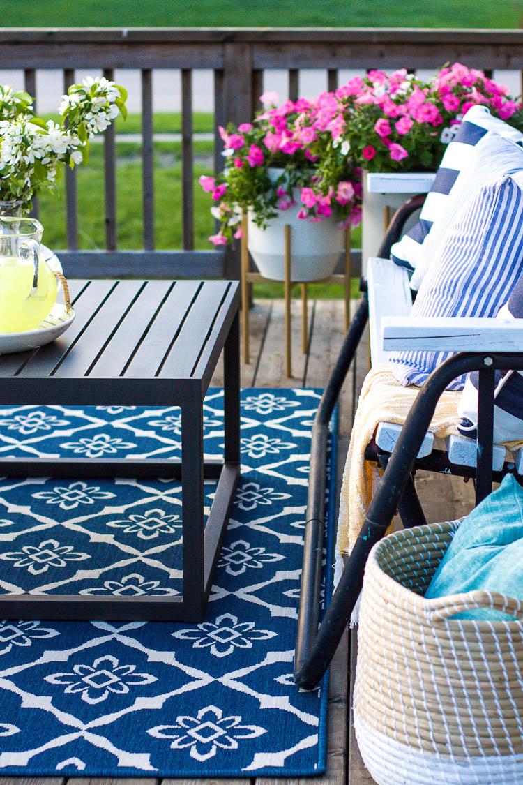 coffee-table-on-blue-area-rug-on-deck