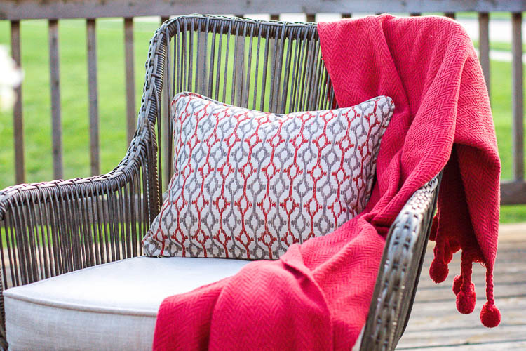 wicker-patio-chair-with-pillow-and-blanket