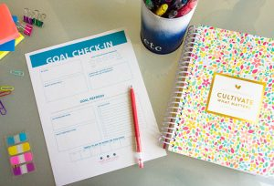 goal-setting-worksheet-and-powersheets-on-desk