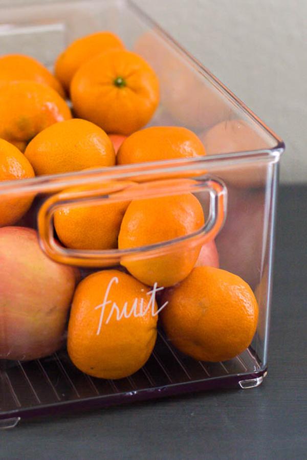 home-edit-label-sticker-on-bin-of-oranges
