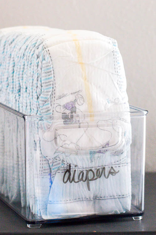 dry-erase-handwritten-label-on-container-of-diapers