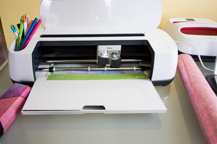 cricut-maker-on-table-cutting-infusible-ink