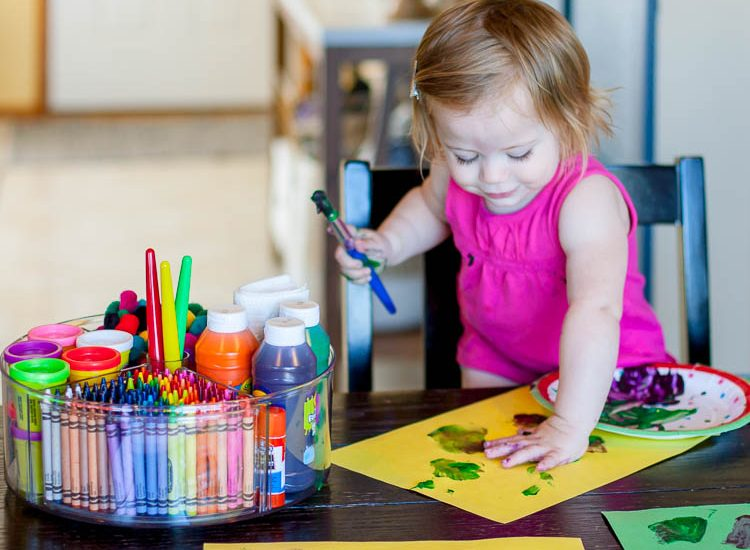 toddler-finger-painting-at-kitchen-table