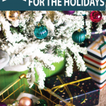 christmas-ornaments-under-flocked-christmas-tree