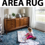 toddler-coloring-on-floor-with-navy-rug-and-mid-century-credenza