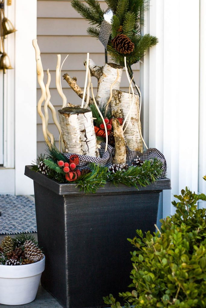 holiday-planter-with-birch-branches-on-front-porch