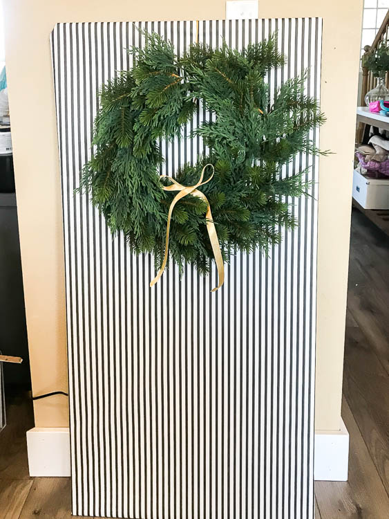 wrapped-canvas-with-wreath-hanging-on-it