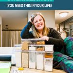 emily-counts-on-table-with-clear-pantry-containers