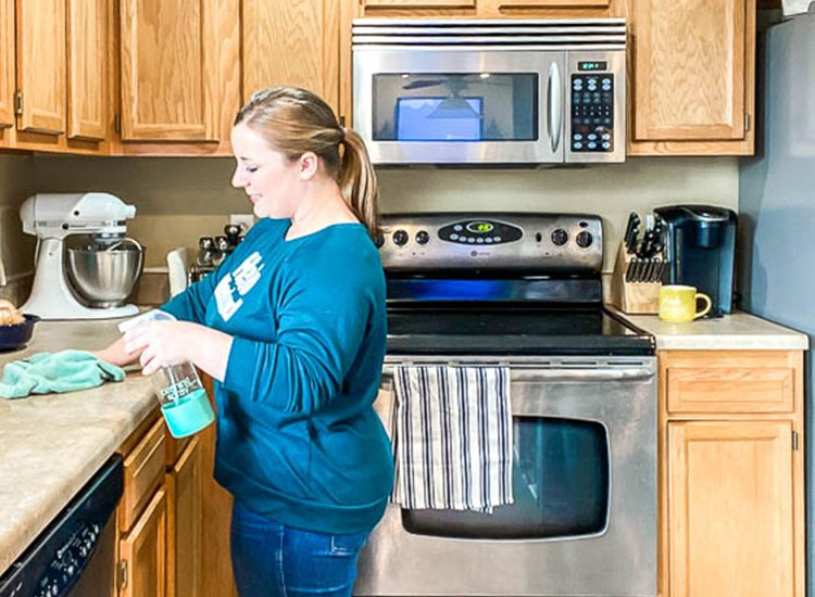 woman-cleaning-kitchen-counters
