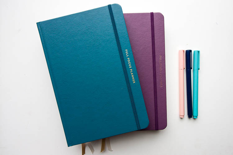 blue-and-purple-full-focus-planners-on-table