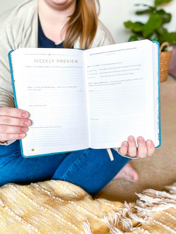emily-counts-holding-full-focus-planner