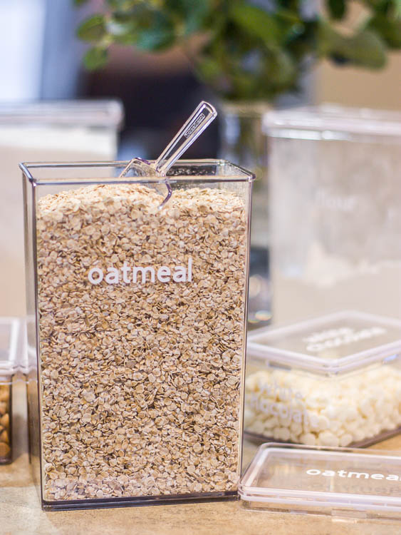 """clear canister with oatmeal and a white vinyl """"oatmeal"""" label"""
