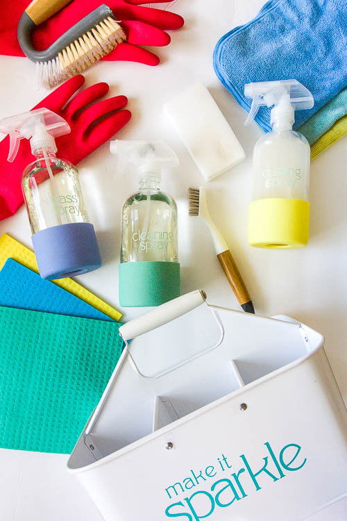 colorful cleaning supplies and cleaning caddy