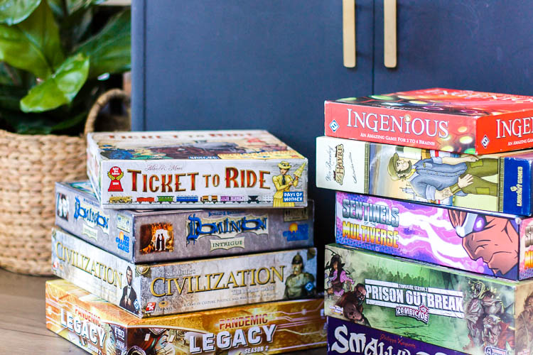 board-games-in-two-stacks-on-floor