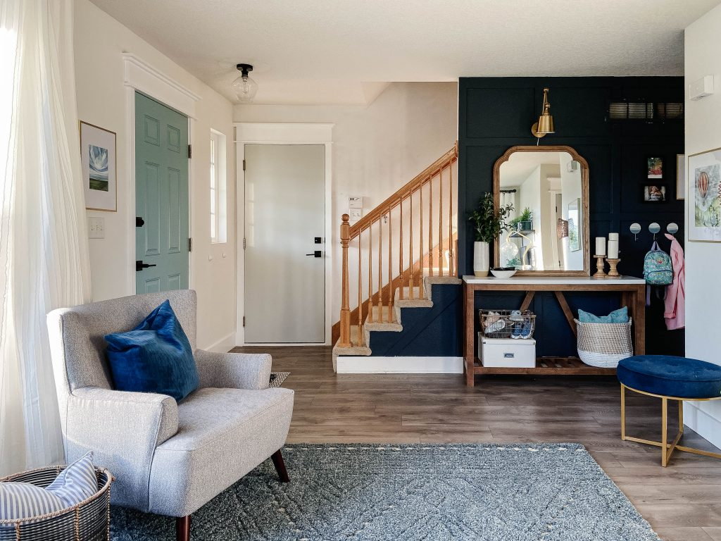 stylish entryway with blue and gray accents
