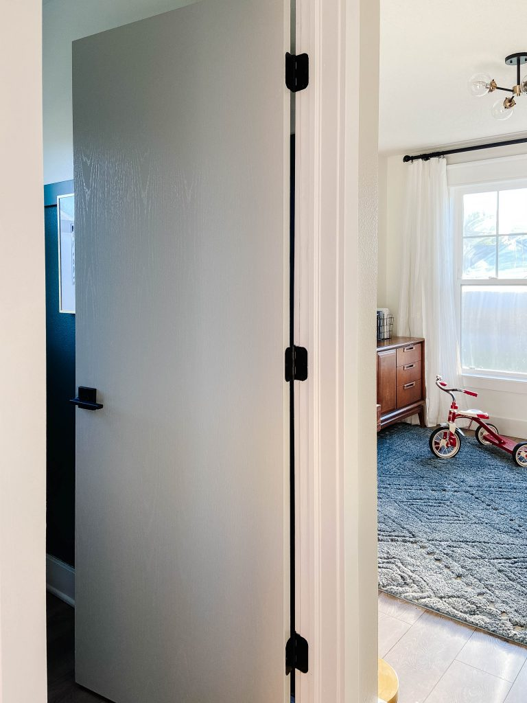 painted interior door and child's trike