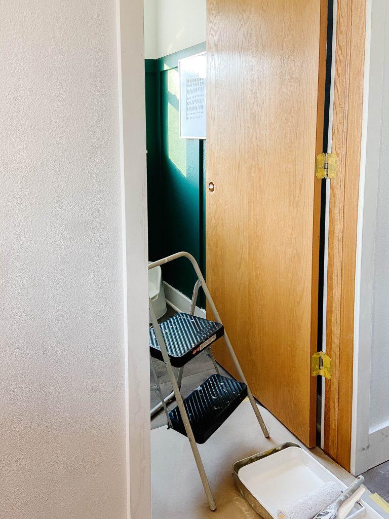 open door and stepladder