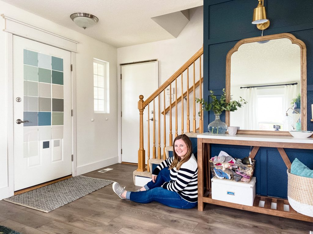 female sitting in entryway considering paint color options for front door