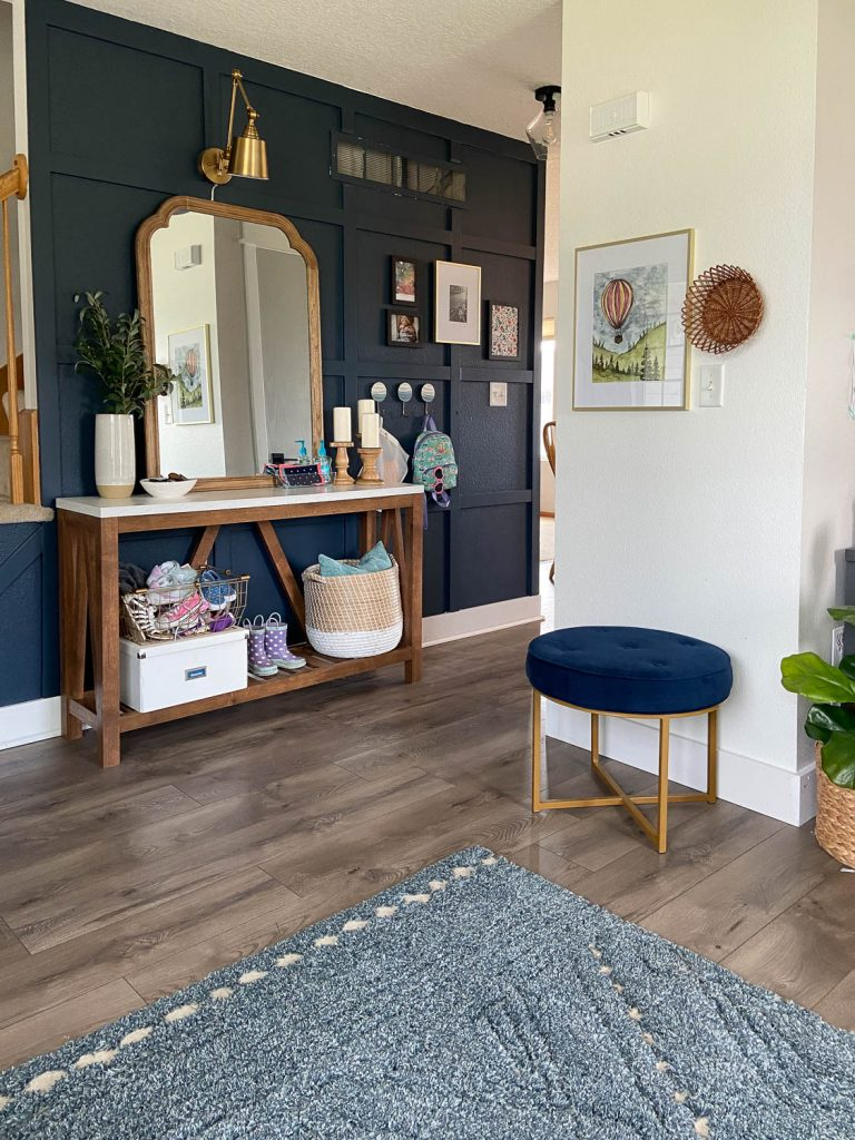 small entryway with face masks on table