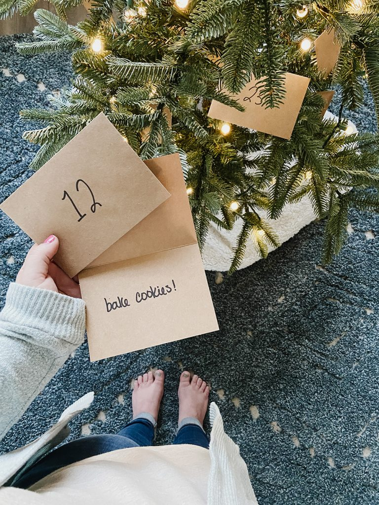 hand holding envelope from advent calendar