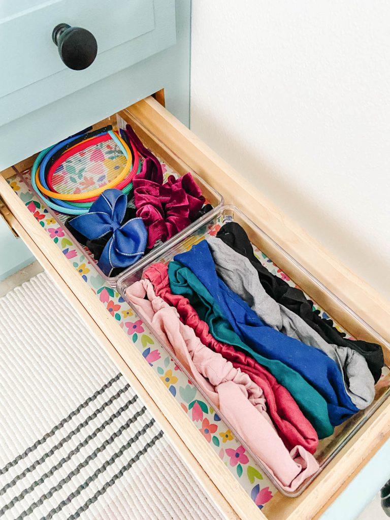 organized hair supplies in bathroom drawer
