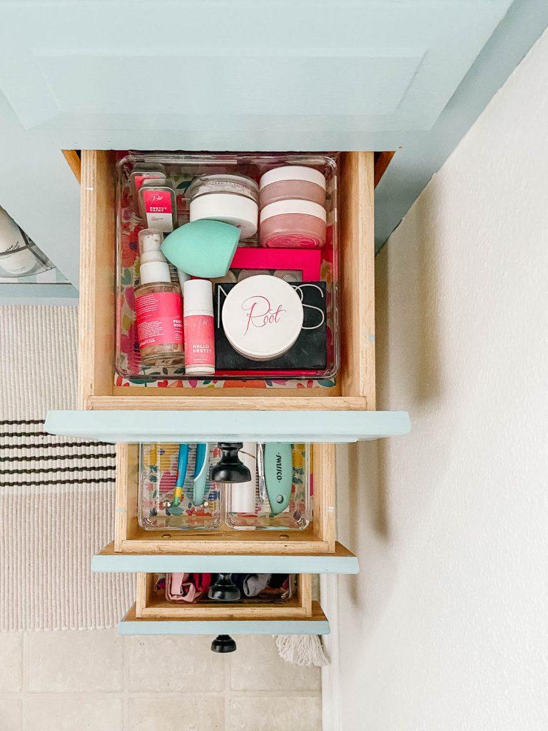 photo showing woman's organized bathroom drawers