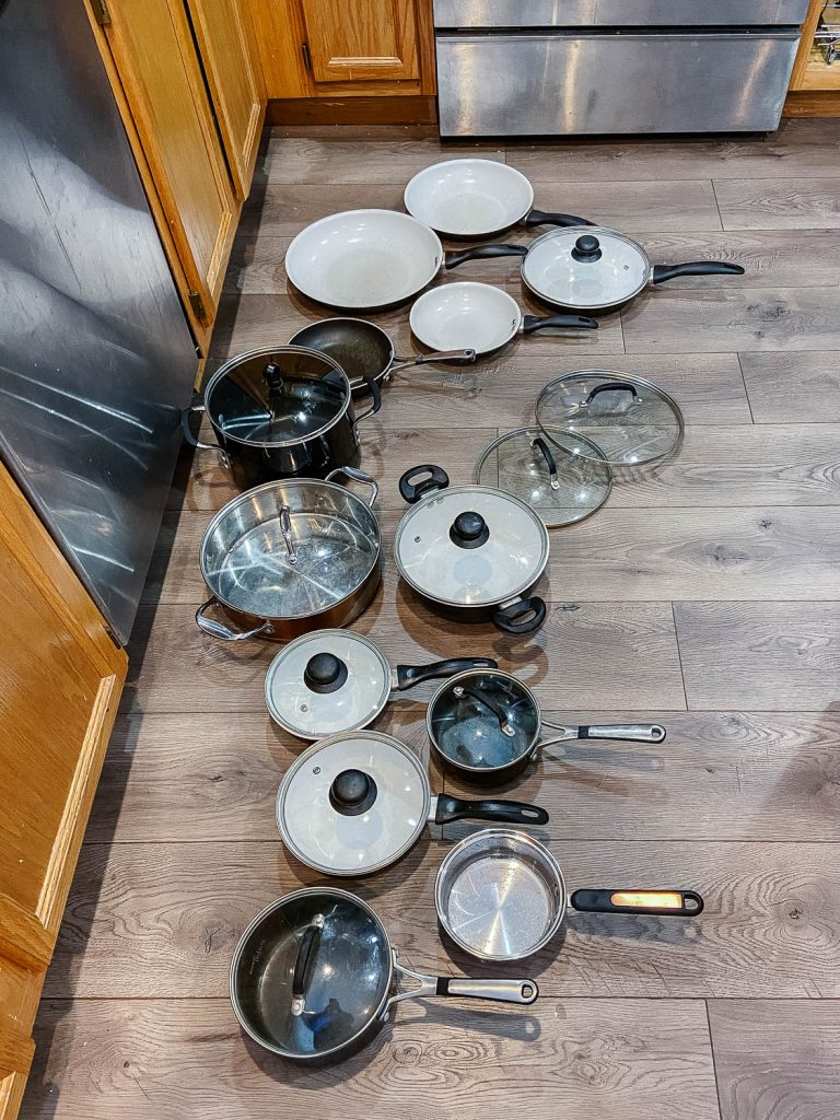 pots and pans sitting on kitchen floor