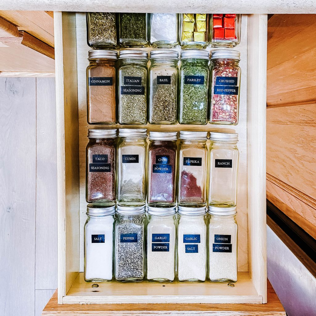 drawer filled with labeled spice jars