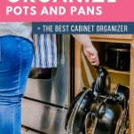 woman taking pan out of cabinet