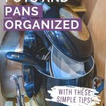 pots and pans in kitchen cabinet