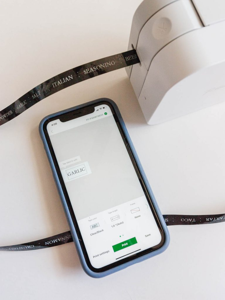 image of label maker and phone creating labels for spices