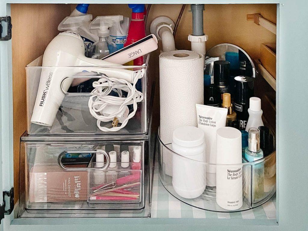 organized bathroom sink cabinet