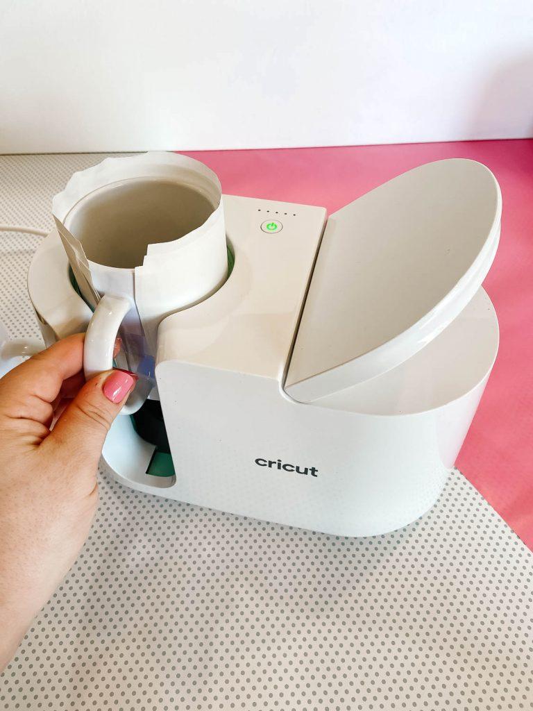 Inserting mug in the Cricut Mug Press