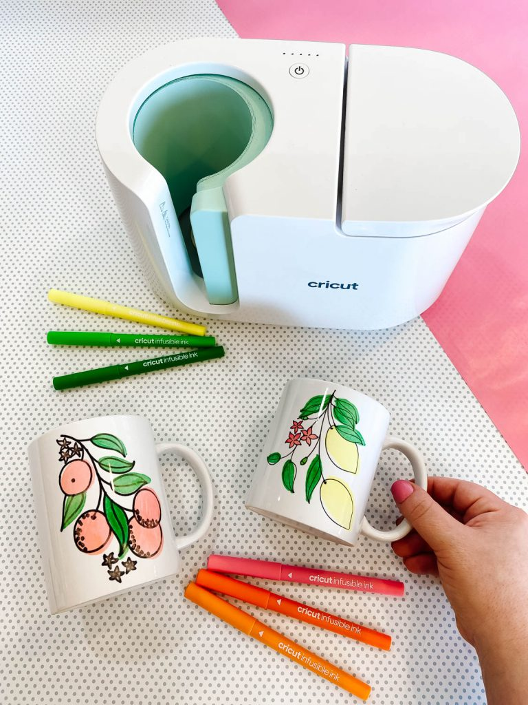 Cricut Mug Press with 2 mugs on table
