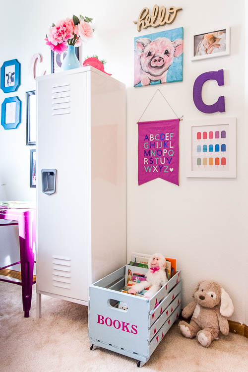 cute nursery with gallery wall and cute book crate