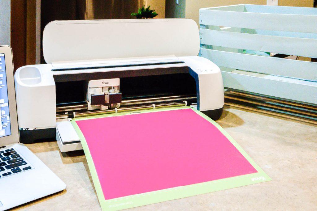 Cricut Maker cutting pink vinyl