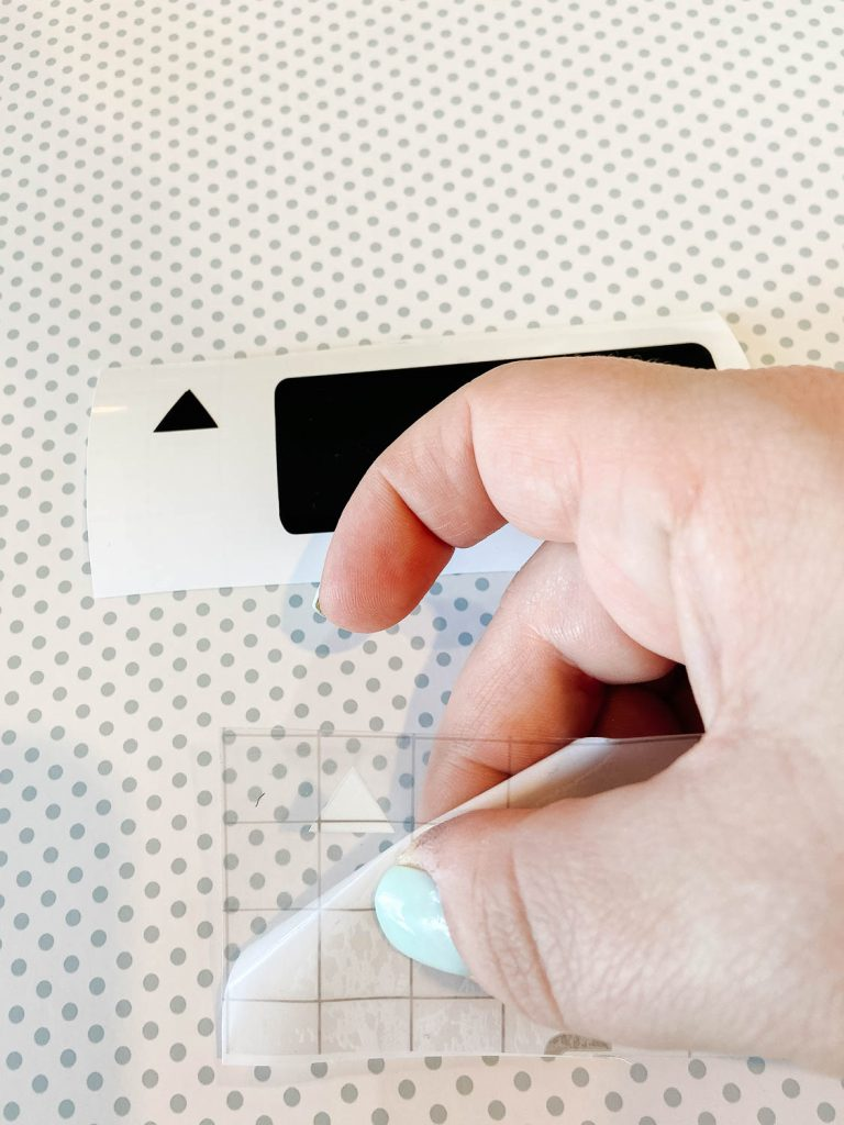 hand peeling backing off vinyl