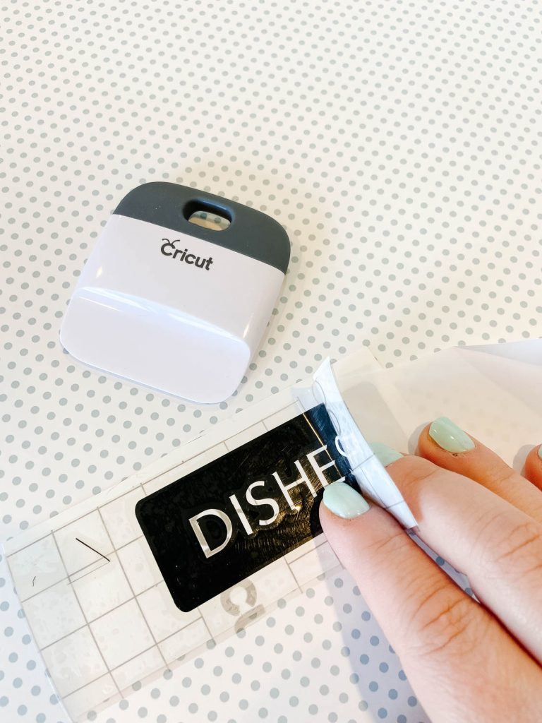 """Dishes"" vinyl with Cricut scraper"