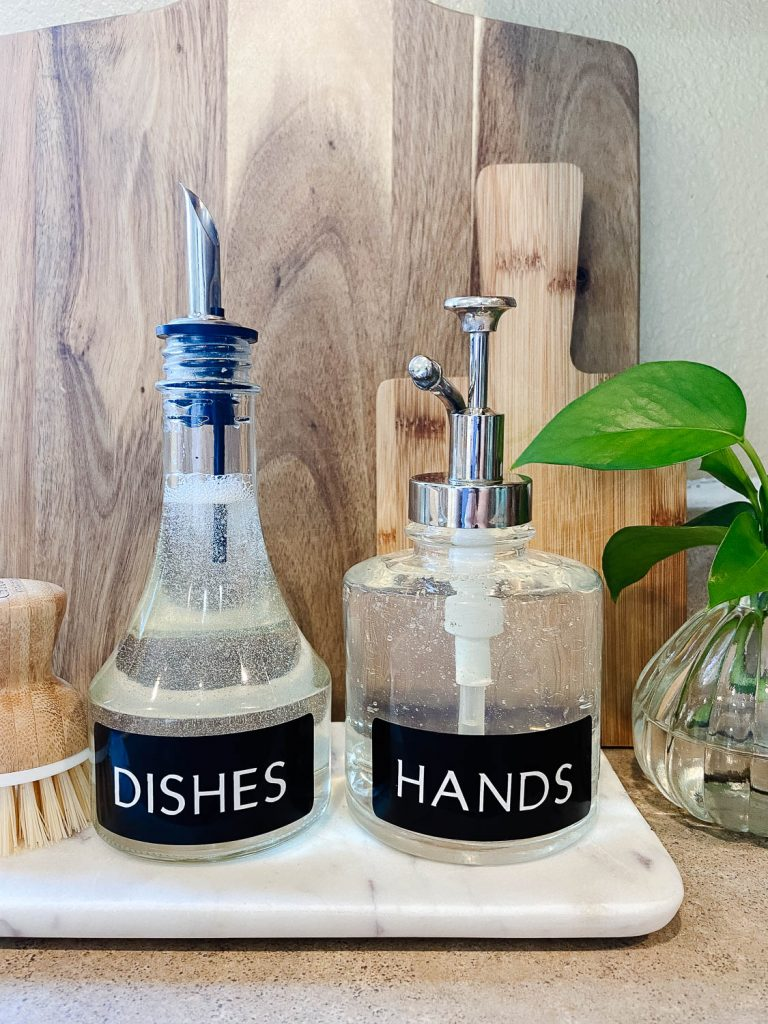 clear bottles on marble tray