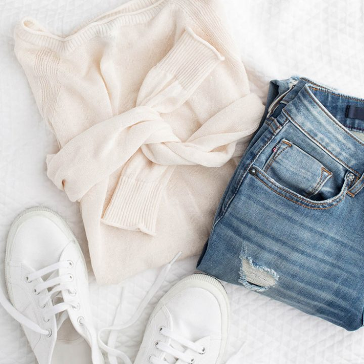 sweater and jeans flatlay