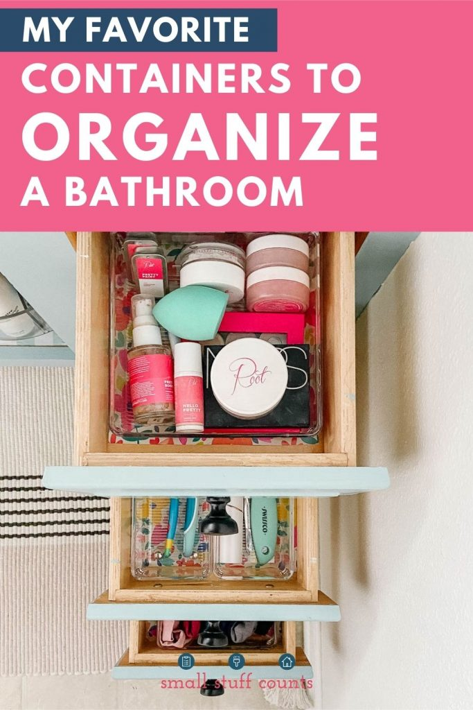 three drawers open on a bathroom vanity