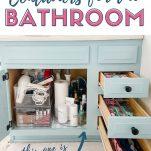 bathroom vanity with open drawers and door